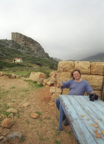 Terry Moyemont at the archaeologist's table in Falasarna, Crete.